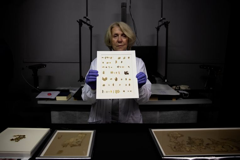 Curator Tania Pettler displays newly discovered fragments of the Dead Sea Scrolls in a laboratory in Jerusalem.  AP image