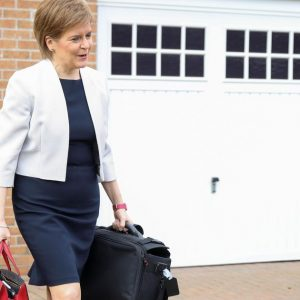 The Scottish 'heroine' tosses a sturgeon but remains upright  Abroad