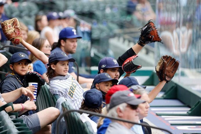 Fans of the Milwaukee Brewers standing with the Texas Rangers during the final game of production