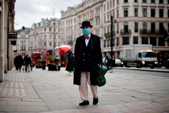 A man wears a mouth mask in London.