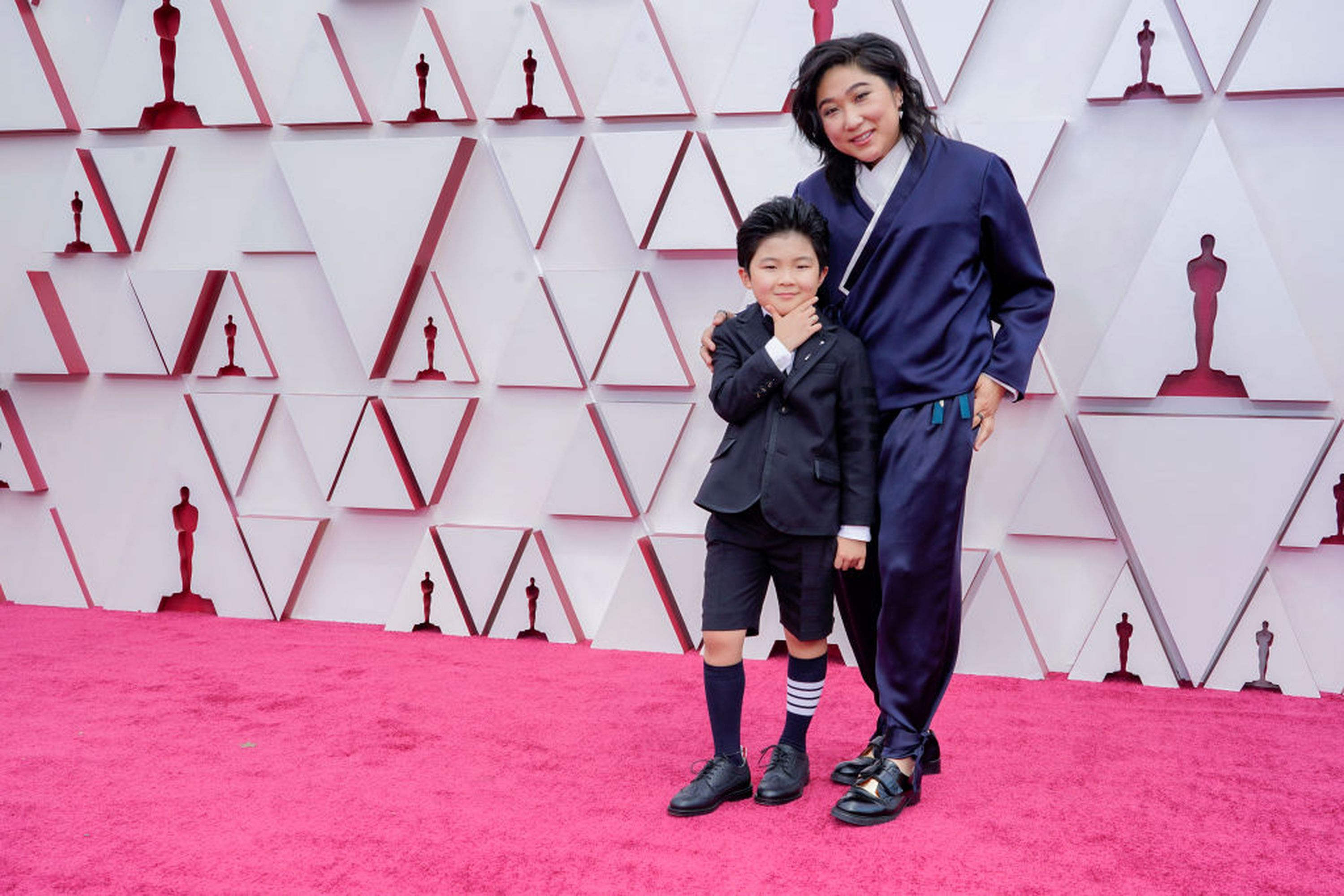 LOS ANGELES, CA - April 25: (LR) Alan S. Kim and Christina Oh attend the 93rd Annual Academy Awards at Union Station on April 25, 2021 in Los Angeles, California.  (Photo by Chris Bisillo-Ball / Getty Images)