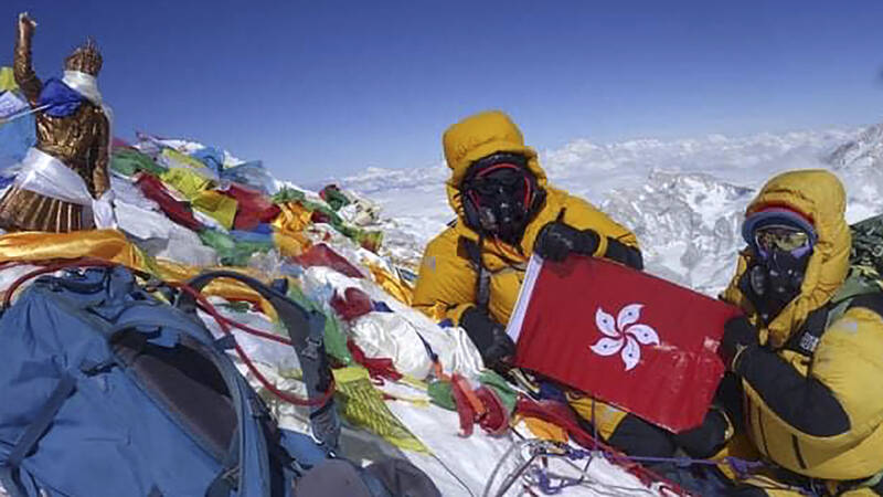 Good weather on Mount Everest and the records are raining