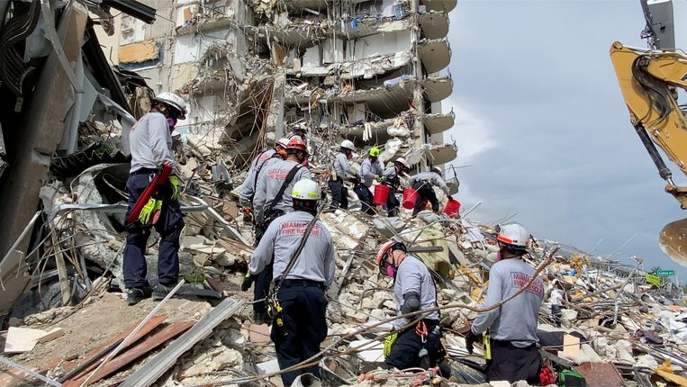 Rescue teams are working on unstable hills of cement and steel in hopes of finding survivors.  Image via Reuters