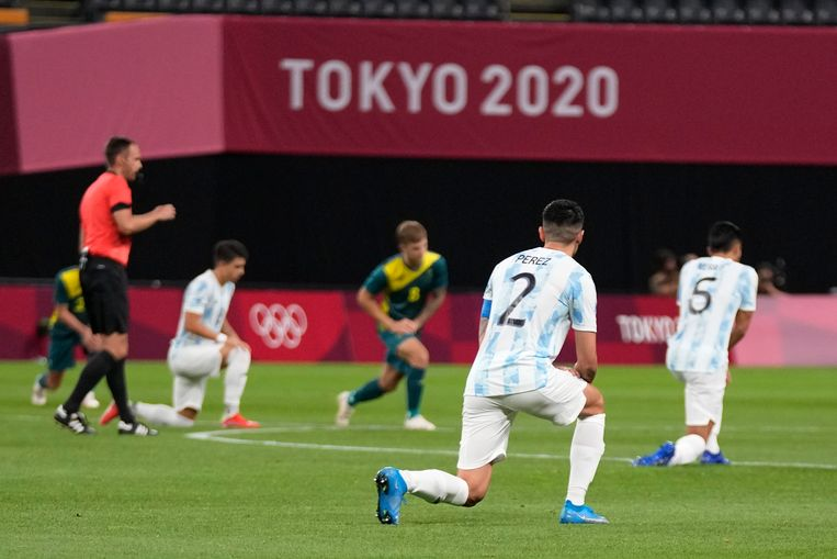 Football players from Argentina and Australia kneel to protest racism ahead of their Olympic game on Thursday, July 22nd.  AP . image