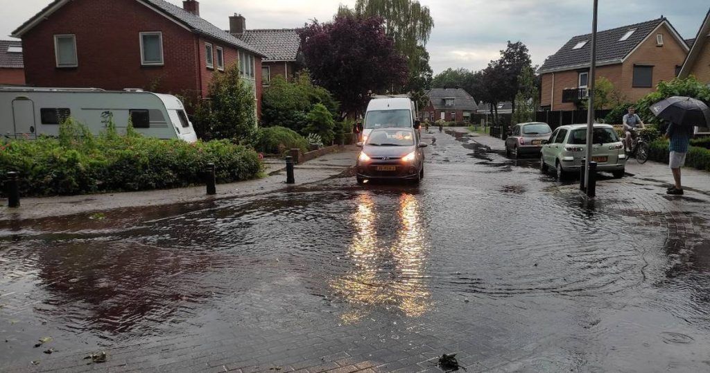 Flooding after clouds burst: a gaping hole in the road and empty streets    interior