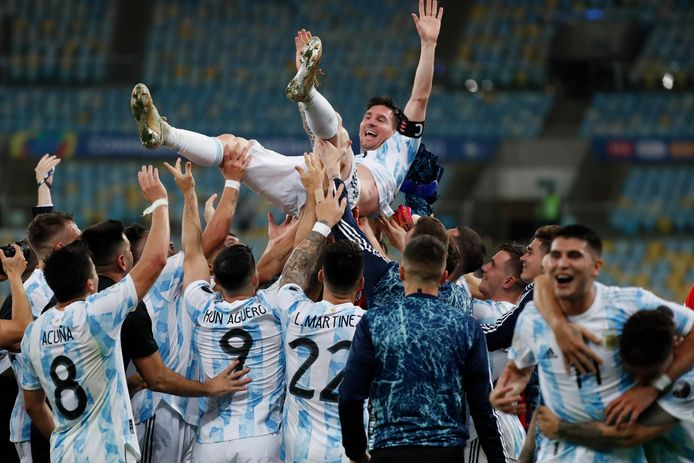Lionel Messi is tossed in the air and greets his teammates after Argentina's victory in the Copa America final.