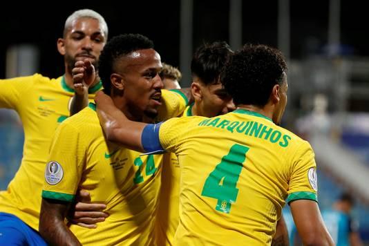 Brazil celebrates Eder Militao's opening goal (14) against Ecuador.