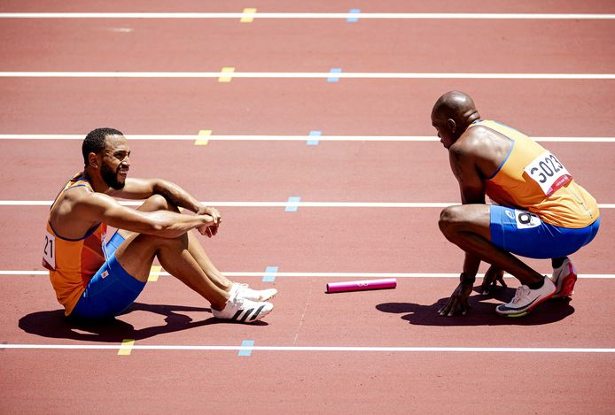 Christopher Garria and Shurandi Martina make a false change during the first round of the men's 4x100m races at the Olympic Stadium during the Athletics Championships at the Olympic Games in Tokyo.