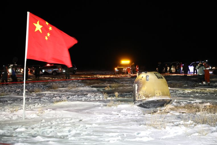 The lunar capsule (right) returned to Earth last December.  CNSA . image